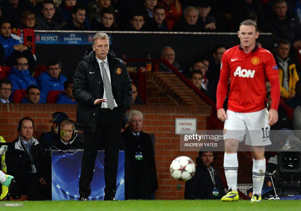 Manchester United's Scottish manager David Moyes gestures during the UEFA Champions League football match between Manchester United and Real Sociedad at Old Trafford in Manchester, north west England on October 23, 2013.