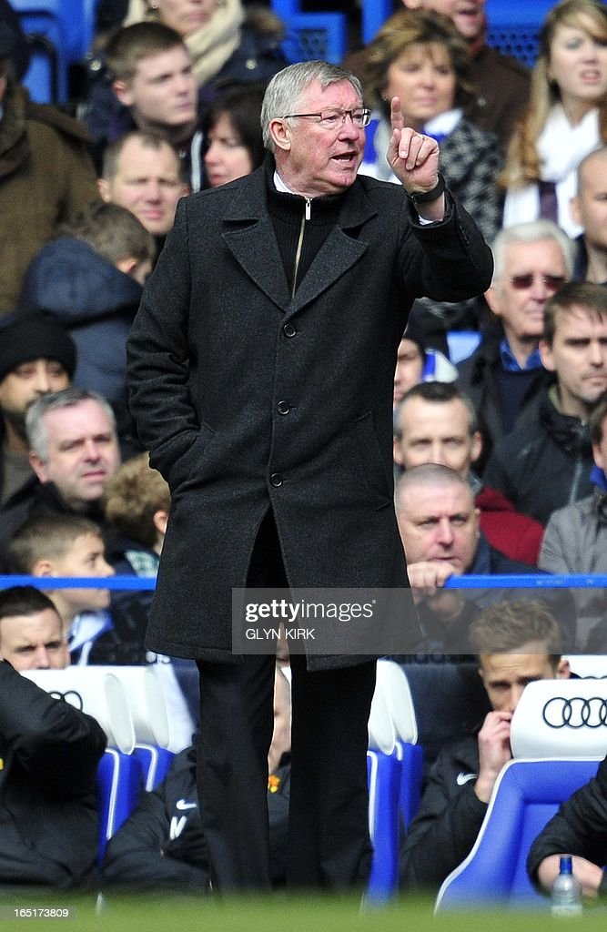 """Manchester United's Scottish manager Sir Alex Ferguson gestures to his players during their English FA Cup quarter final replay football match against Chelsea at Stamford Bridge in London, England on April 1, 2013. Chelsea won 1-0. AFP PHOTO/GLYN KIRK USE. No use with unauthorized audio, video, data, fixture lists, club/league logos or """"live"""" services. Online in-match use limited to 45 images, no video emulation. No use in betting, games or single club/league/player publications."""