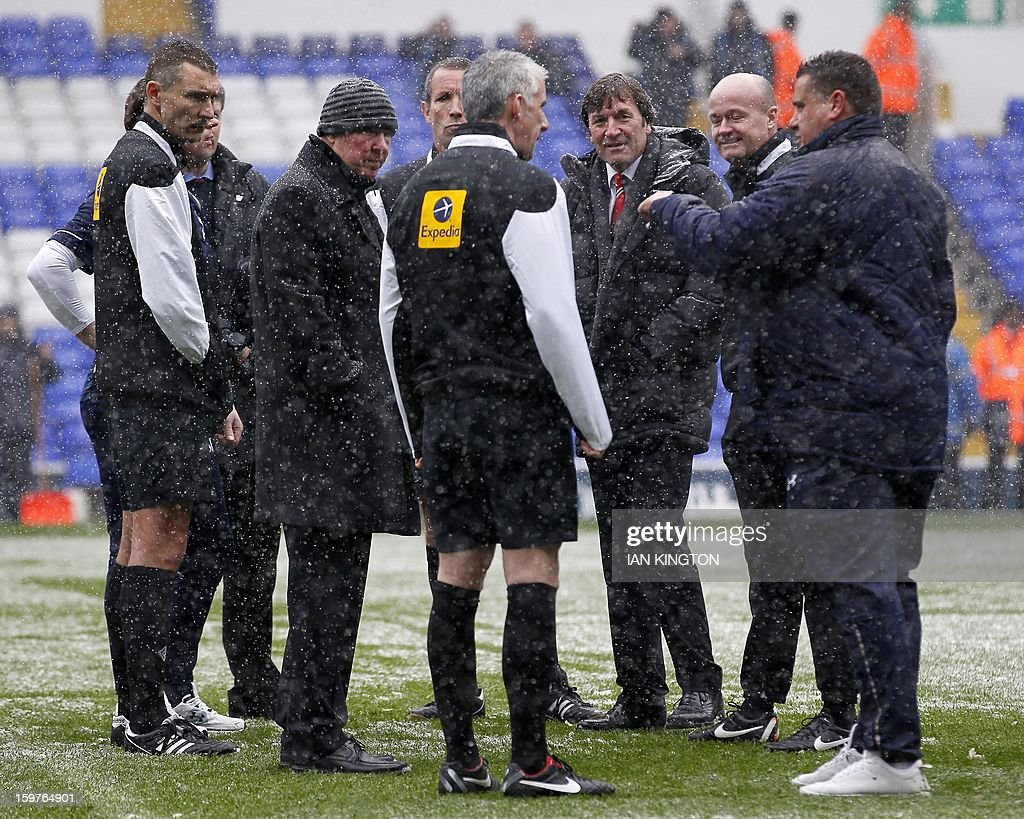 "Manchester United's Scottish Manager Sir Alex Ferguson (2nd L) joins the pitch inspection with referee Chris Foy (c) before kick off during an English Premier League football match between Tottenham Hotspur and Manchester United at White Hart Lane in London, England, on January 20, 2013. AFP PHOTO/Ian KINGTON - RESTRICTED TO EDITORIAL USE. No use with unauthorized audio, video, data, fixture lists, club/league logos or ""live"" services. Online in-match use limited to 45 images, no video emulation. No use in betting, games or single club/league/player publications."