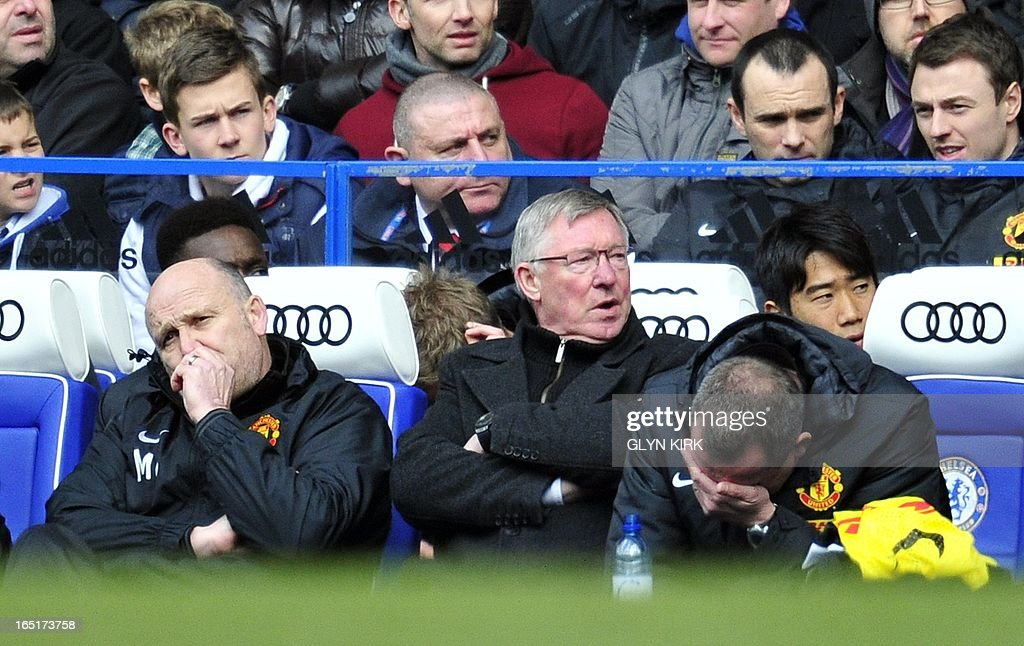 "Manchester United's Scottish manager Sir Alex Ferguson (2ndL) looks on during their English FA Cup quarter final replay football match against Chelsea at Stamford Bridge in London, England on April 1, 2013. Chelsea won 1-0. AFP PHOTO/GLYN KIRK RESTRICTED TO EDITORIAL USE. No use with unauthorized audio, video, data, fixture lists, club/league logos or ""live"" services. Online in-match use limited to 45 images, no video emulation. No use in betting, games or single club/league/player publications."
