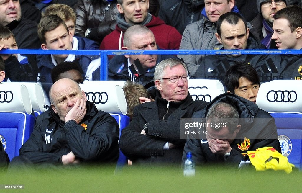 """Manchester United's Scottish manager Sir Alex Ferguson (2ndL) looks on during their English FA Cup quarter final replay football match against Chelsea at Stamford Bridge in London, England on April 1, 2013. Chelsea won 1-0. AFP PHOTO/GLYN KIRK RESTRICTED TO EDITORIAL USE. No use with unauthorized audio, video, data, fixture lists, club/league logos or """"live"""" services. Online in-match use limited to 45 images, no video emulation. No use in betting, games or single club/league/player publications."""