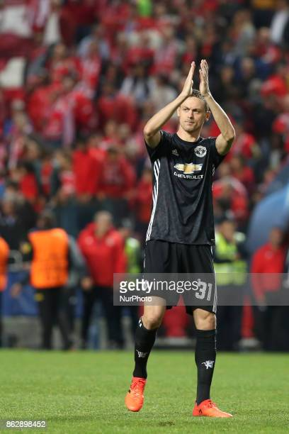 Manchester United's Serbian midfielder Nemanja Matic acknowledges cheers after the UEFA Champions League football match SL Benfica vs Manchester...