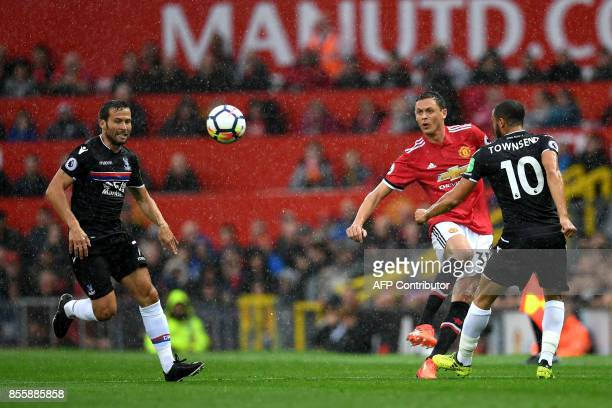 Manchester United's Serbian midfielder Nemanja Matic vies with Crystal Palace's English midfielder Andros Townsend during the English Premier League...