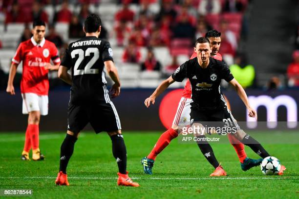 Manchester United's Serbian midfielder Nemanja Matic vies with Benfica's Argentine midfielder Eduardo Salvio during the UEFA Champions League group A...