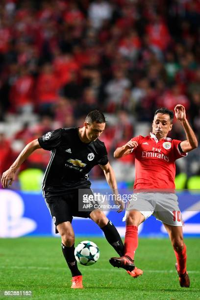 Manchester United's Serbian midfielder Nemanja Matic vies with Benfica's Brazilian forward Jonas Oliveira during the UEFA Champions League group A...