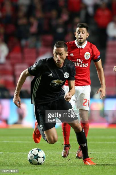 Manchester United's Serbian midfielder Nemanja Matic vies with Benfica's Portuguese midfielder Pizzi during the UEFA Champions League football match...