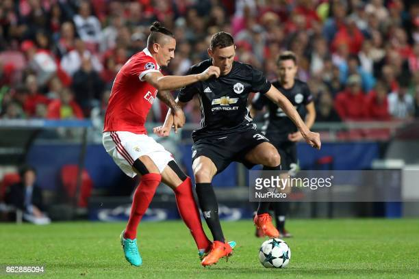 Manchester United's Serbian midfielder Nemanja Matic vies with Benfica's Serbian midfielder Ljubomir Fejsa during the UEFA Champions League football...