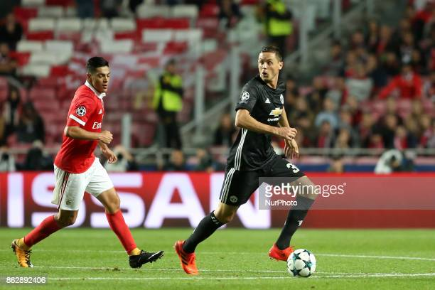 Manchester United's Serbian midfielder Nemanja Matic vies with Benfica's Mexican forward Raul Jimenez during the UEFA Champions League football match...