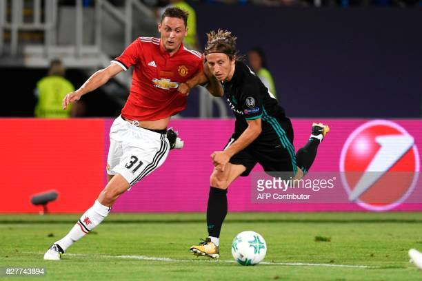 Manchester United's Serbian midfielder Nemanja Matic vies with Real Madrid's Croatian midfielder Luka Modric during the UEFA Super Cup football match...