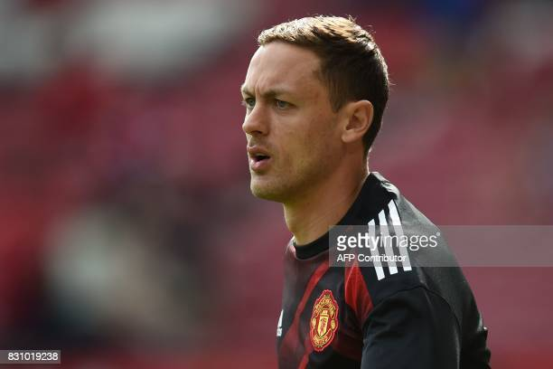 Manchester United's Serbian midfielder Nemanja Matic warms up ahead of the English Premier League football match between Manchester United and West...