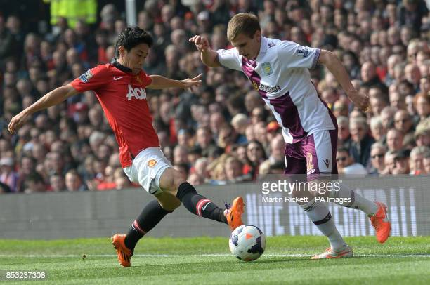 Manchester United's Shinji Kagawa battles for the ball Aston Villa's Marc Albrighton during the Barclays Premier League match at Old Trafford...
