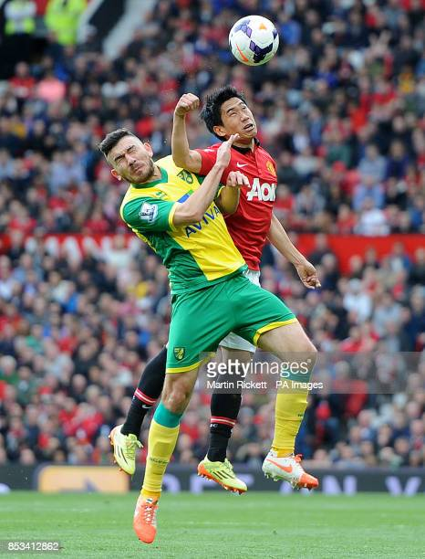 Manchester United's Shinji Kagawa battles for the ball with Norwich City's Bradley Johnson during the Barclays Premier League match at Old Trafford...