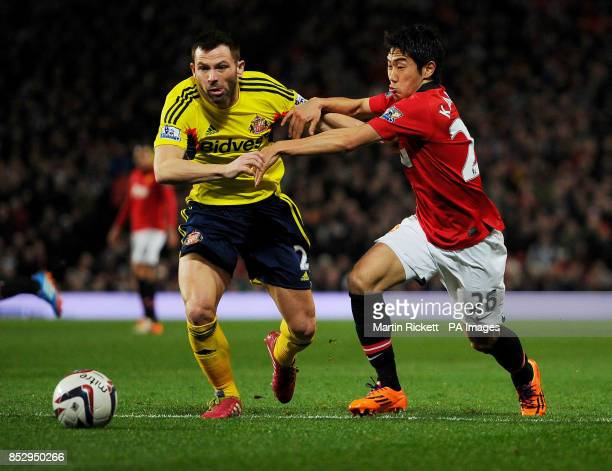 Manchester United's Shinji Kagawa battles for the ball with Sunderland's Phil Bardsley during the Capital One Cup Semi Final Second Leg at Old...