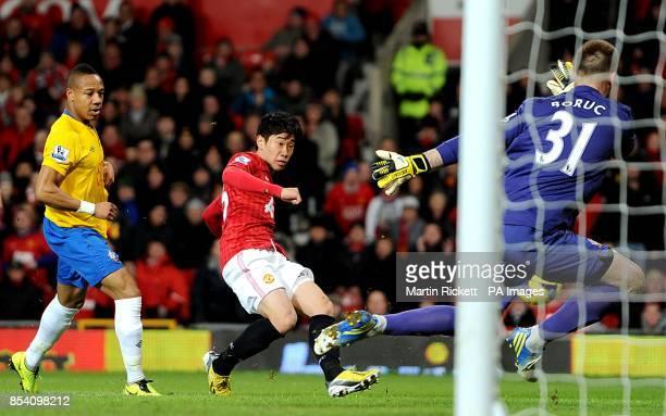 Manchester United's Shinji Kagawa has a shot on goal saved by Southampton goalkeeper Artur Boruc