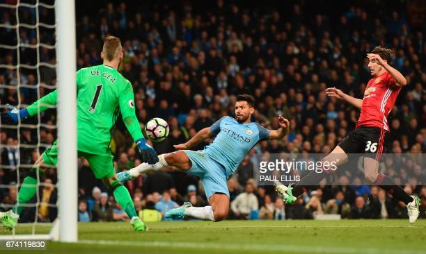 Manchester United's Spanish goalkeeper David de Gea and Manchester United's Italian defender Matteo Darmian defend against a shot from Manchester...