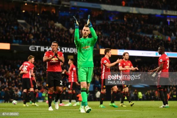 Manchester United's Spanish goalkeeper David de Gea applauds their fans at the end of the English Premier League football match between Manchester...