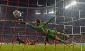 Manchester United's Spanish goalkeeper David de Gea fails to save Bayern Munich's midfielder Thomas Mueller's shot for the 21 goal during the UEFA...