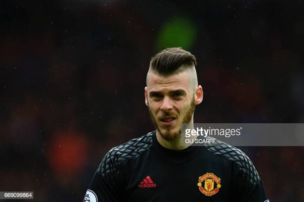 Manchester United's Spanish goalkeeper David de Gea looks on prior to the English Premier League football match between Manchester United and Chelsea...