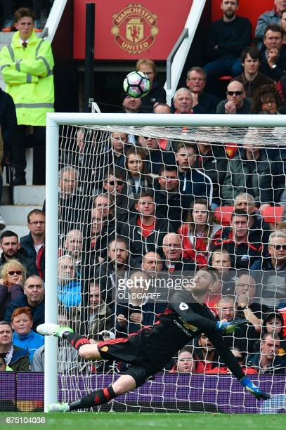 Manchester United's Spanish goalkeeper David de Gea makes a reaction save during the English Premier League football match between Manchester United...