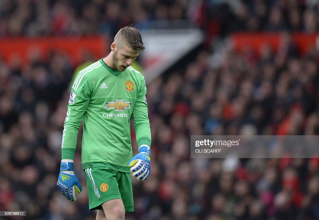 Manchester United's Spanish goalkeeper David de Gea plays during the English Premier League football match between Manchester United and Leicester City at Old Trafford in Manchester, north west England, on May 1, 2016. / AFP / OLI SCARFF / RESTRICTED TO EDITORIAL USE. No use with unauthorized audio, video, data, fixture lists, club/league logos or 'live' services. Online in-match use limited to 75 images, no video emulation. No use in betting, games or single club/league/player publications. /