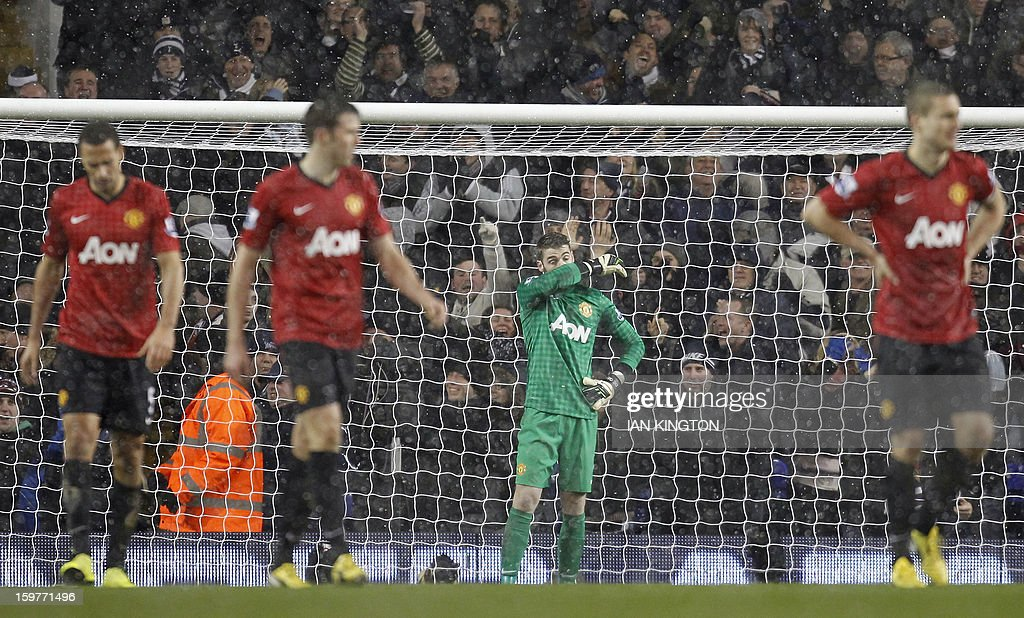 """Manchester United's Spanish goalkeeper David De Gea (C) reacts after Tottenham Hotspur's equalising goal by US striker Clint Dempsey during the English Premier League football match between Tottenham Hotspur and Manchester United at White Hart Lane in London on January 20, 2013. A stoppage-time goal by Clint Dempsey saw Tottenham Hotspur snatch a 1-1 draw at home to Manchester United on that prevented the Premier League leaders from restoring their seven-point lead. USE. No use with unauthorised audio, video, data, fixture lists, club/league logos or """"live"""" services. Online in-match use limited to 45 images, no video emulation. No use in betting, games or single club/league/player publications."""