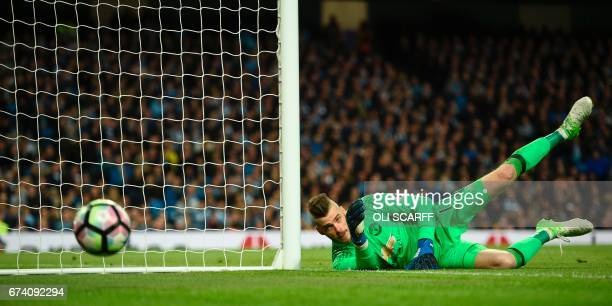 Manchester United's Spanish goalkeeper David de Gea saves a shot during the English Premier League football match between Manchester City and...