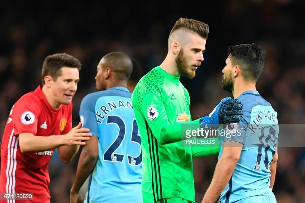 Manchester United's Spanish goalkeeper David de Gea talks with Manchester City's Argentinian striker Sergio Aguero after an altercation between...