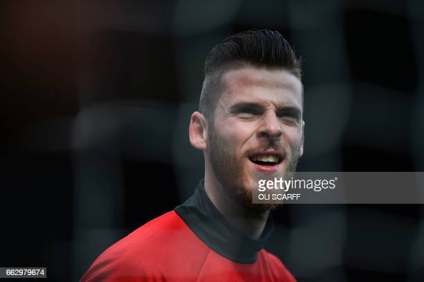 Manchester United's Spanish goalkeeper David de Gea warms up ahead of the English Premier League football match between Manchester United and West...