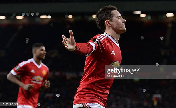 Manchester United's Spanish midfielder Ander Herrera celebrates scoring his team's fourth goal from the penalty spot with Manchester United's English...