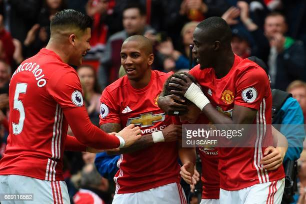 Manchester United's Spanish midfielder Ander Herrera celebrates scoring the second goal with teammates during the English Premier League football...
