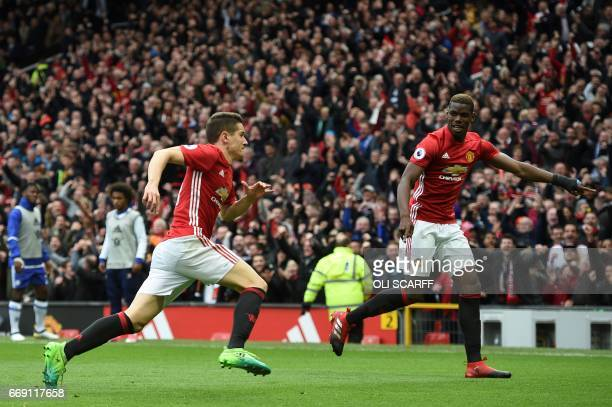 Manchester United's Spanish midfielder Ander Herrera celebrates scoring their second goal with Manchester United's French midfielder Paul Pogba...