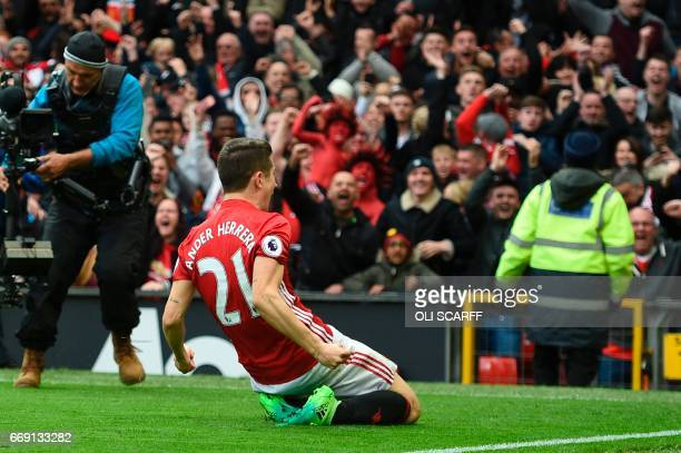 Manchester United's Spanish midfielder Ander Herrera celebrates scoring their second goal during the English Premier League football match between...