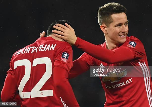 Manchester United's Spanish midfielder Ander Herrera congratulates Manchester United's Armenian midfielder Henrikh Mkhitaryan after Mkhitaryan scored...