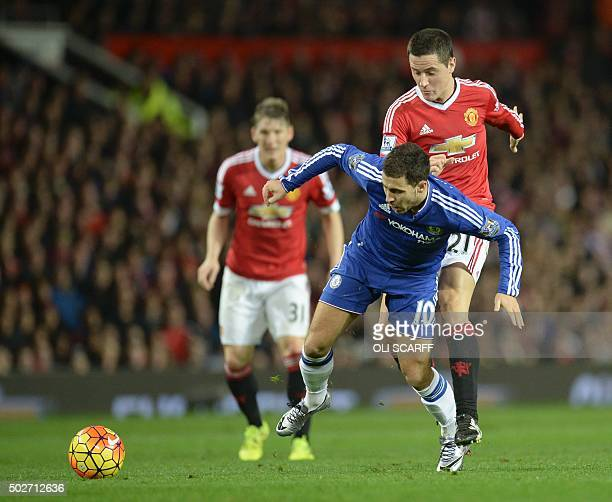 Manchester United's Spanish midfielder Ander Herrera fouls Chelsea's Belgian midfielder Eden Hazard during the English Premier League football match...