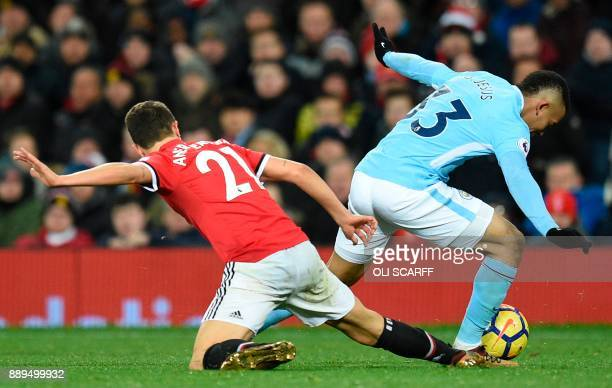 Manchester United's Spanish midfielder Ander Herrera fouls Manchester City's Brazilian striker Gabriel Jesus to concede a free kick during the...