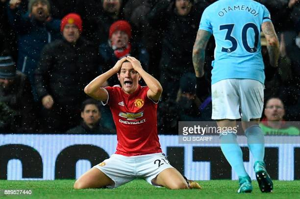 Manchester United's Spanish midfielder Ander Herrera reacts to a decision from the referee who judged he was not fouled in the box during the English...