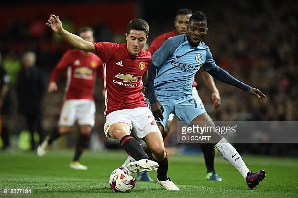 Manchester United's Spanish midfielder Ander Herrera vies with Manchester City's Nigerian striker Kelechi Iheanacho during the EFL Cup fourth round...