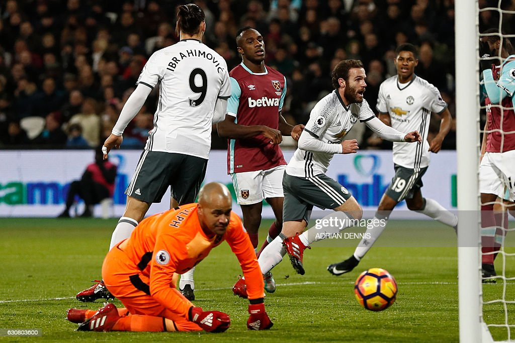 Manchester United's Spanish midfielder Juan Mata (C) celebrates after scoring the opening goal of the English Premier League football match between West Ham United and Manchester United at The London Stadium, in east London on January 2, 2017. / AFP / Adrian DENNIS / RESTRICTED TO EDITORIAL USE. No use with unauthorized audio, video, data, fixture lists, club/league logos or 'live' services. Online in-match use limited to 75 images, no video emulation. No use in betting, games or single club/league/player publications. /