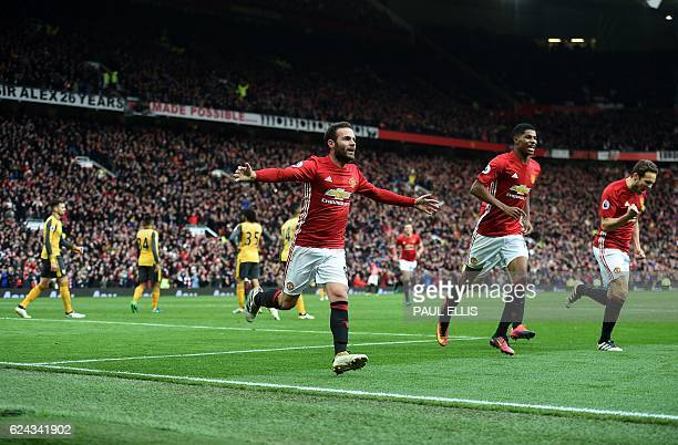 Manchester United's Spanish midfielder Juan Mata celebrates scoring his team's first goal during the English Premier League football match between...