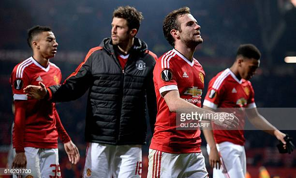 Manchester United's Spanish midfielder Juan Mata reacts as he leaves the pitch after the UEFA Europa League round of 16 second leg football match...