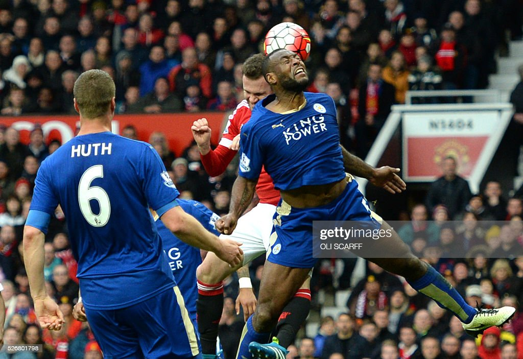 Manchester United's Spanish midfielder Juan Mata (2R) rises up against Leicester City's English defender Wes Morgan (R) for a header during the English Premier League football match between Manchester United and Leicester City at Old Trafford in Manchester, north west England, on May 1, 2016. / AFP / OLI SCARFF / RESTRICTED TO EDITORIAL USE. No use with unauthorized audio, video, data, fixture lists, club/league logos or 'live' services. Online in-match use limited to 75 images, no video emulation. No use in betting, games or single club/league/player publications. /