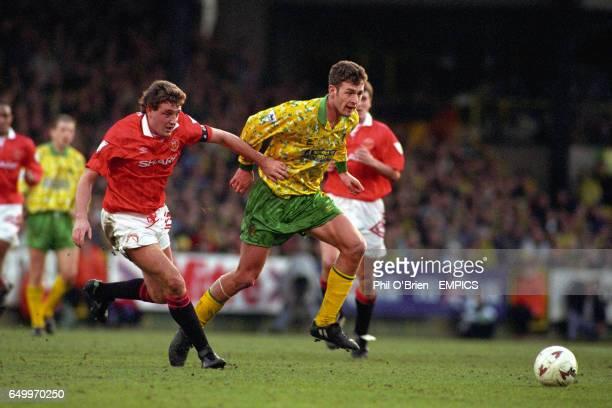 Manchester United's Steve Bruce pulls back Norwich City's Chris Sutton