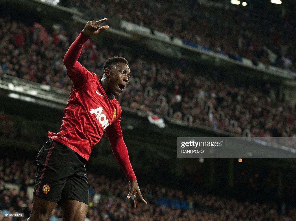Manchester United's striker Danny Welbeck celebrates after scoring during the UEFA Champions League round of 16 first leg football match Real Madrid CF vs Manchester United FC at the Santiago Bernabeu stadium in Madrid on February 13, 2013. The match ended in a 1-1 draw.