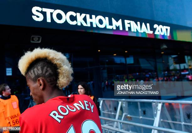 A Manchester United's supporter stands outside the stadium ahead the UEFA Europa League final football match Ajax Amsterdam v Manchester United on...