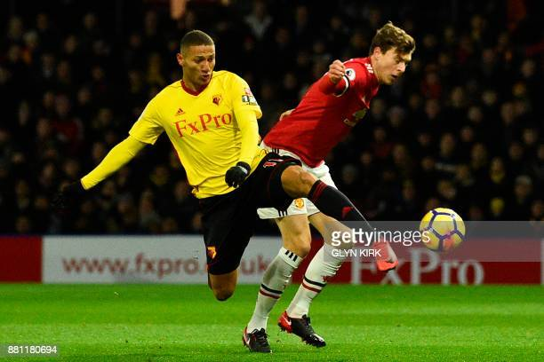 Manchester United's Swedish defender Victor Lindelof cuts across to defend against Watford's Brazilian striker Richarlison de Andrade during the...