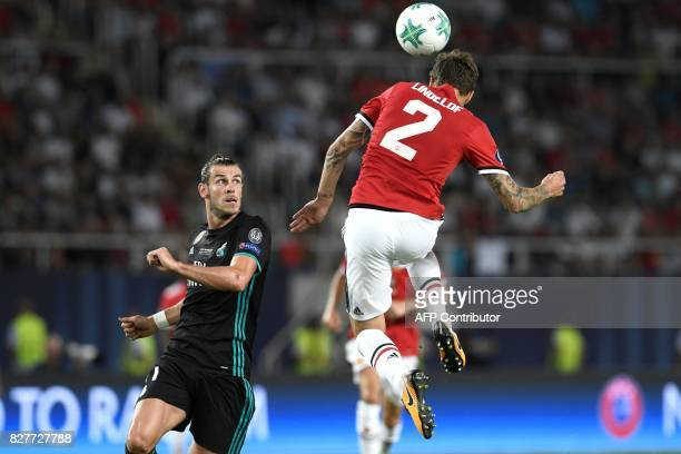 Manchester United's Swedish defender Victor Lindelof heads the ball before Real Madrid's Welsh forward Gareth Bale during the UEFA Super Cup football...