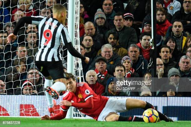 Manchester United's Swedish defender Victor Lindelof looks on from the floor after slipping as Newcastle United's English forward Dwight Gayle scores...
