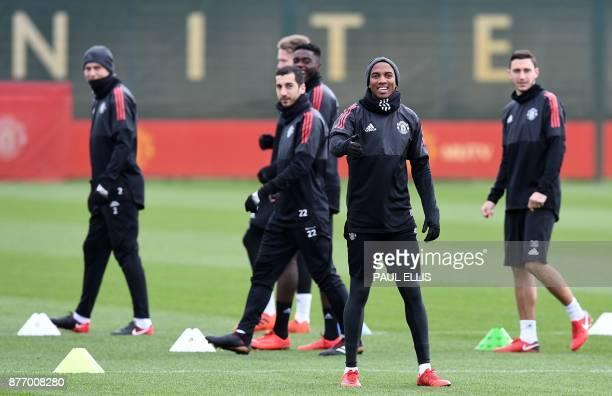 Manchester United's Swedish defender Victor Lindelof Manchester United's Armenian midfielder Henrikh Mkhitaryan Manchester United's English...