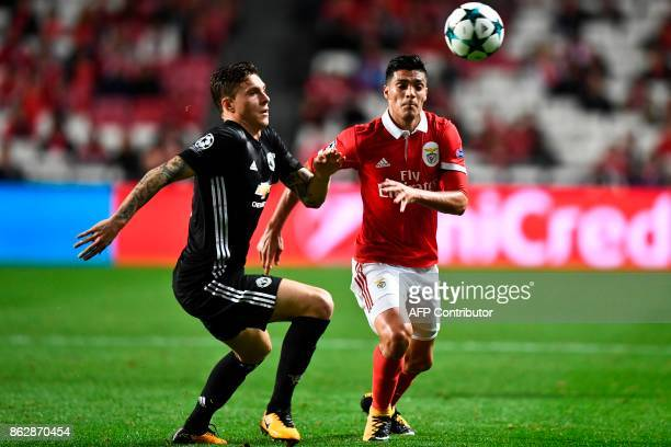Manchester United's Swedish defender Victor Lindelof vies with Benfica's Mexican forward Raul Jimenez during the UEFA Champions League group A...