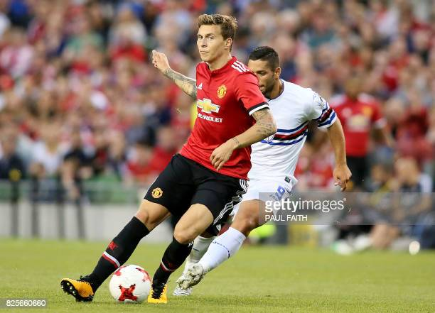 Manchester United's Swedish defender Victor Lindelof vies with Sampdoria's Gianluca Caprari during the preseason friendly game between Manchester...
